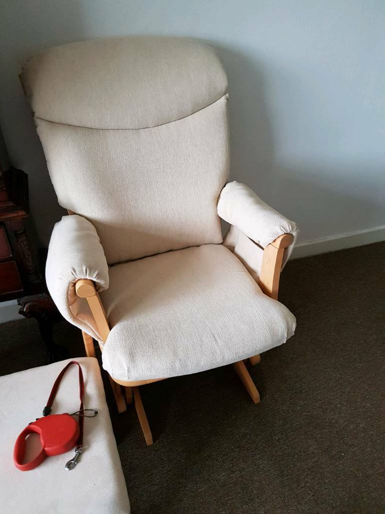 2 lovely cream rocking chairs and one rocking foot stool