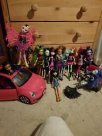12 monster high dolls and a car for dolls