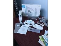 Boxed Wii + accessories + games