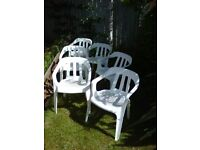 6 white plastic garden/patio chairs in good condition .
