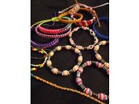 A selection of bracelets as pictured - all unworn - selling as joblot!