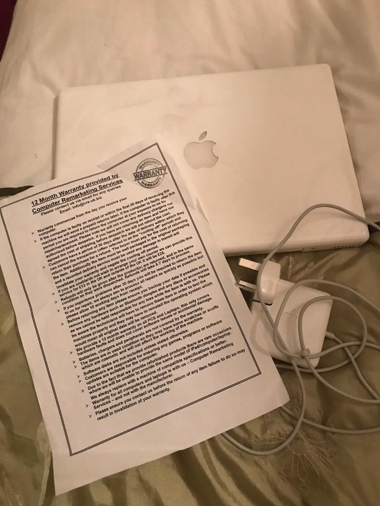 Apple white MacBook A1181 250GB laptop with charger and warranty