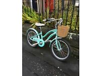 GIRLS 20 inch Raleigh West Bay bike in mint green. 2 years old and in good condition.