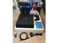 Used once. PlayStation 4 Pro 1TB jet black console