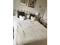 White leather bedstead and white bedroom furniture