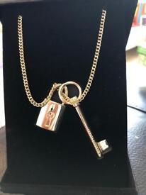 Victoria's Secret lock and Key necklace. Brand new. Gold plated.