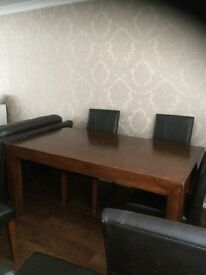 Solid table and 6 chairs and sideboard