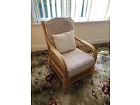 Conservatory / garden cane chair with cream upholstery