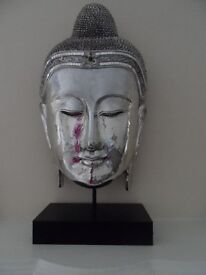 large silver buddha head on stand ornament