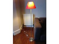 Floor lamp with red lamp shade