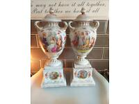 Pair of antique porcelain double handed lidded urns