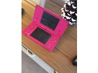 Pink Nintendo Dsi and gamea
