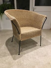 Metal framed wicker arm chair