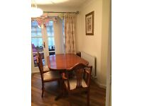 Yew dining table and 6 chairs including 2 carvers