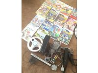 Black Nintendo Wii with 14 games