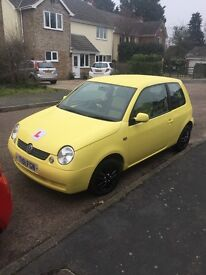 Volkswagen Lupo 1.4 Auto in bright yellow benefitting from long MOT. E/W C/L P/S and low miles.