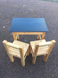 Children's solid wood table and chairs with blackboard - good condition