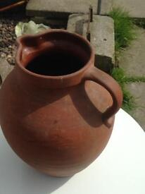 Plant table and clay jug