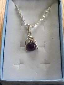 Ladies genuine sterling silver pendant with a genuine amethyst stone