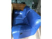 Double leather reclining sofa and matching pouffe.