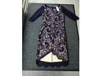 Navy lace party dress size 12, with nude lining and shaped hem,new with tags