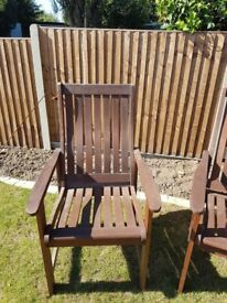 6 hardwood garden chairs. Kept in garage. Good condition although may need a little TLC.