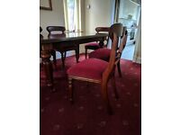 Great condition mahogany table and six chairs