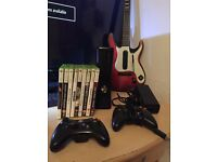 xbox 360 slim console with 3 controllers, 1 guitar and all leads