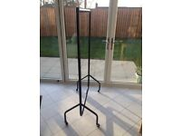 Pair of clothes rails from Ikea: large black and small red.