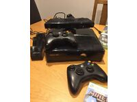 Xbox 360 console, 2 controllers, charger and 16 games