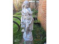 Garden statue of girl on plinth stone heavy