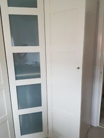 IKEA wardrobe Bergsbo white wood doors 236 H x 50 W x 60 D with rack, shelve, 2 drawers and basket
