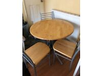 Round ikea table & 3 chairs, wood & metal, very modern, perfect for small dining room.