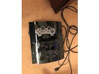 PS3 console. 3 controls and a selection of games
