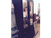 Black wardrobe with drawers