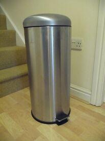Stainless steel kitchen waste bin with flip lid.