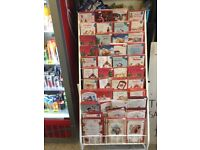 White metal foldable card stand with 300 Christmas cards