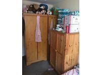 Solid pine 3door wardrobe, one two door and a single door one.