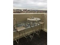 Vintage look two tall metal chairs and table