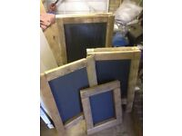 Brand new set of four rustic advertising board (A-board) chalkboard pavement sign menu-board