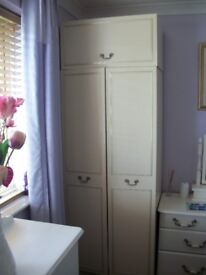 two single wardrobes with top boxes in cream