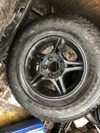 Four jeep alloy wheels and tyres