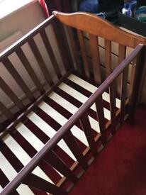 Dark Wooden Baby's Cot