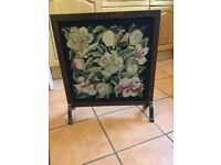 A wooden framed fire screen. In excellent condition