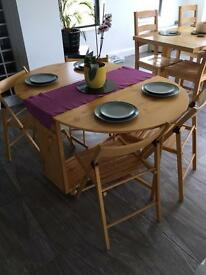 Drop leaf table and fold away chairs
