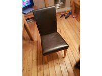 Walnut finish table and 5 leather look chairs