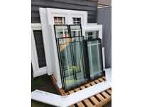 Eurocell UPVC windows various sizes c/w handles/cills 6/4mm laminated sound proof glass - 1 year old