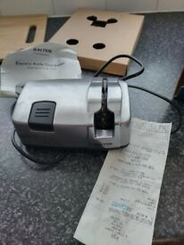 Electric knife sharpener, as new