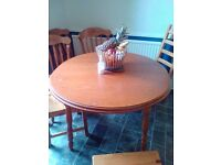 Round kitchen table nice condition seats five or six eooden