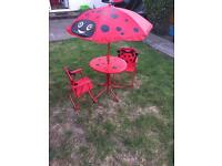 Kids table and chairs with parasol
